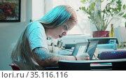 Young blonde woman tattoo artist draws sketch for tattoo in studio. Стоковое видео, видеограф Константин Шишкин / Фотобанк Лори