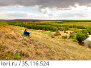 A man is not sitting on the side of a hill or admiring the endless expanses of the Russian forest-steppe on a spring day. Стоковое фото, фотограф Акиньшин Владимир / Фотобанк Лори