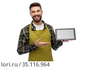 happy male gardener or farmer with tablet pc. Стоковое фото, фотограф Syda Productions / Фотобанк Лори