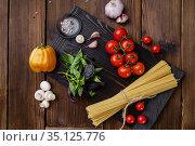 Fresh vegetables and spaghetti, wooden background. Стоковое фото, фотограф Tryapitsyn Sergiy / Фотобанк Лори