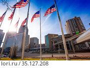 USA flags poles on the Jefferson Avenue in Detroit (2018 год). Стоковое фото, фотограф Сергей Новиков / Фотобанк Лори