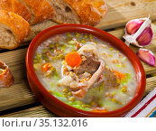 Soup of lamb with pearl barley, green peas and cabbage in bowl. Стоковое фото, фотограф Яков Филимонов / Фотобанк Лори