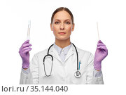 female doctor with test tube and cotton swab. Стоковое фото, фотограф Syda Productions / Фотобанк Лори