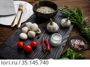 Fresh vegetables on board and rice in plate. Стоковое фото, фотограф Tryapitsyn Sergiy / Фотобанк Лори