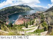 Wide angle view of the Kotor Gulf or Boka Kotorska with medieval town, sea port with ferryboats and surrounding mountains. Montenegro, Europe (2016 год). Стоковое фото, фотограф Кекяляйнен Андрей / Фотобанк Лори