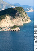 The Sveti Nikola is Montenegro's largest island, stretching to nearly 2 km. The Budva city, Montenegro (2016 год). Стоковое фото, фотограф Кекяляйнен Андрей / Фотобанк Лори