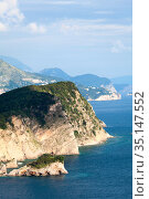 The Sveti Nikola or St. Nicolas island is in Budva riviera. Cliffs rise above the Adriatic sea. Montenegro (2016 год). Стоковое фото, фотограф Кекяляйнен Андрей / Фотобанк Лори
