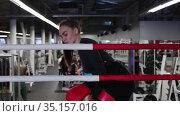 Young pretty woman walks to a boxing ring in the gym. Стоковое видео, видеограф Константин Шишкин / Фотобанк Лори
