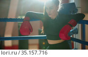 An attractive young woman with long hair resting on the boxing ring. Стоковое видео, видеограф Константин Шишкин / Фотобанк Лори