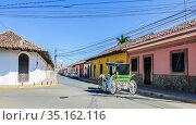 Street with colourful houses, Granada, founded in 1524, Nicaragua, Central America. Редакционное фото, фотограф Николай Коржов / Фотобанк Лори