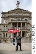 Lansing, Michigan USA - 14 December 2020 - As Michigan's presidential... Редакционное фото, фотограф Jim West / age Fotostock / Фотобанк Лори