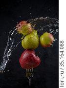 apples and pear on fork and Splashing water. Стоковое фото, фотограф Александр Иванов / Фотобанк Лори