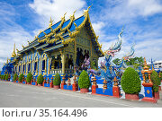 Ubosot of Buddhist temple of Wat Rong Sear Tean (Blue Temple) close-up sunny day. Chiang Rai, Thailand (2018 год). Стоковое фото, фотограф Виктор Карасев / Фотобанк Лори
