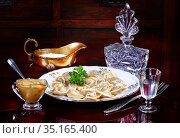 Dumplings with vodka with sour cream and mustard. Стоковое фото, фотограф Марина Володько / Фотобанк Лори