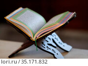 Open Holy Quran on wood stand. France. Стоковое фото, фотограф Pascal Deloche / Godong / age Fotostock / Фотобанк Лори