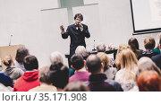 Speaker Giving a Talk at Business Meeting. Стоковое фото, фотограф Matej Kastelic / Фотобанк Лори