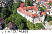 Aerial view of impressive medieval Gewerkenegg Castle in small Slovenian township of Idrija on sunny autumn day. Стоковое видео, видеограф Яков Филимонов / Фотобанк Лори