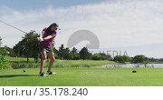 Caucasian woman playing golf taking a shot from bunker. Стоковое видео, агентство Wavebreak Media / Фотобанк Лори