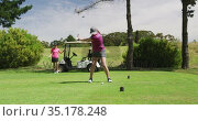 Two caucasian women playing golf one taking shot from bunker. Стоковое видео, агентство Wavebreak Media / Фотобанк Лори