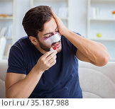 Young man recovering healing at home after plastic surgery nose. Стоковое фото, фотограф Elnur / Фотобанк Лори