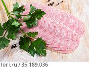 Traditional catalan sliced sausage with parsley. Стоковое фото, фотограф Яков Филимонов / Фотобанк Лори