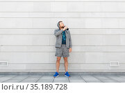 sportsman with bottle drinking water in city. Стоковое фото, фотограф Syda Productions / Фотобанк Лори