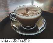 Mug with cappuccino on the table. Стоковое фото, фотограф Юрий Бизгаймер / Фотобанк Лори