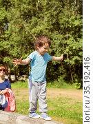Boy walks on a log. Стоковое фото, фотограф Юлия Бабкина / Фотобанк Лори