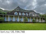 Clouds on mountains over Eureka La Maison Creole house and garden... (2019 год). Редакционное фото, фотограф Roberto Moiola / age Fotostock / Фотобанк Лори