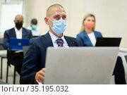 portrait of caucasian male businessman in meet room during quarantine. Стоковое фото, фотограф Яков Филимонов / Фотобанк Лори