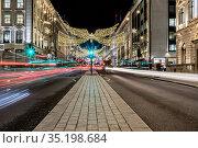 Regent Street light trails at night, London, England, United Kingdom... Стоковое фото, фотограф Chris Mouyiaris / age Fotostock / Фотобанк Лори