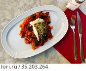 Cod confit with vegetable ratatouille on plate. Стоковое фото, фотограф Яков Филимонов / Фотобанк Лори