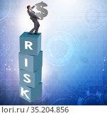 Businessman in risk and reward business concept. Стоковое фото, фотограф Elnur / Фотобанк Лори