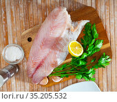 Raw seafood, fresh perch fillet on board. Стоковое фото, фотограф Яков Филимонов / Фотобанк Лори