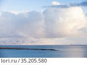 Icelandic coastal landscape. Snowy mountains and clouds. Стоковое фото, фотограф EugeneSergeev / Фотобанк Лори