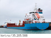 General Cargo Ship with blue hull is moored in port (2017 год). Стоковое фото, фотограф EugeneSergeev / Фотобанк Лори