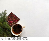 Cup of tea and Chocolate bar with seeds and berries. concept winter greeting post card with place for text. Стоковое фото, фотограф Мария Сибатрова / Фотобанк Лори
