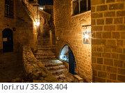 A narrow street in the ancient city of Jaffa at night. Tel Aviv, Israel (2015 год). Редакционное фото, фотограф Наталья Волкова / Фотобанк Лори