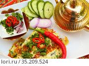 Indian omelet with vegetables and white sauce with tea on a beautiful red tablecloth with ornament. Стоковое фото, фотограф Марина Володько / Фотобанк Лори