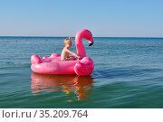 Girl swims on an inflatable flamingo in the sea. Стоковое фото, фотограф Арестов Андрей Павлович / Фотобанк Лори