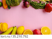 Fresh vegetables and fruits on purple background. Стоковое фото, фотограф Tryapitsyn Sergiy / Фотобанк Лори
