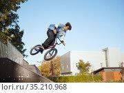 Male bmx biker, jump in action, skatepark. Стоковое фото, фотограф Tryapitsyn Sergiy / Фотобанк Лори