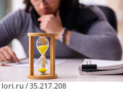 Young male writer in time management concept. Стоковое фото, фотограф Elnur / Фотобанк Лори