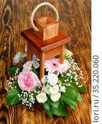 DIY Wooden decorative lantern with beautiful flowers. Стоковое фото, фотограф Бражников Андрей / Фотобанк Лори