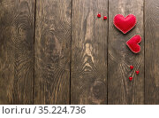 Valentine's day card in minimal style. Two red hearts and small decor on gray boards with place for writing. Стоковое фото, фотограф Сергей Молодиков / Фотобанк Лори