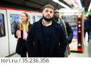 Male passenger on subway platform. Стоковое фото, фотограф Яков Филимонов / Фотобанк Лори