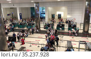 Tourists passport control and line to baggage security check service are in departure terminal of Fraport TAV Antalya Airport. Russian travellers boarding to flight. Antalya, Turkey. Редакционное видео, видеограф Кекяляйнен Андрей / Фотобанк Лори