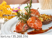 Image of lamb chops on a bed of vegetables Eggplant stuffed with vegetables... Стоковое фото, фотограф Zoonar.com/Andrey Sergeiko / easy Fotostock / Фотобанк Лори