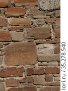 Texture of stone wall, background of old rough masonry from natural stones, medieval wall of castle or fortress. Стоковое фото, фотограф Андрей Копылов / Фотобанк Лори