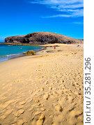 Footstep coast people stone volcanic spain water in lanzarote sky... Стоковое фото, фотограф Zoonar.com/LKPRO / easy Fotostock / Фотобанк Лори